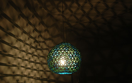 A pendant lamp made from strips of paper. No glue has been used in the making of this lamp.