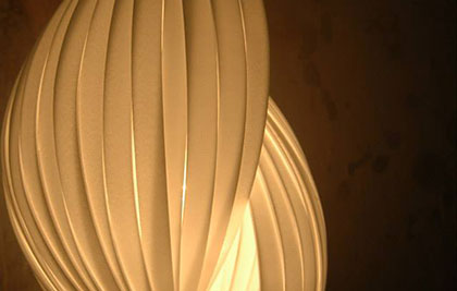 A pendant lamp made from Styrofoam & shaped like a shell.